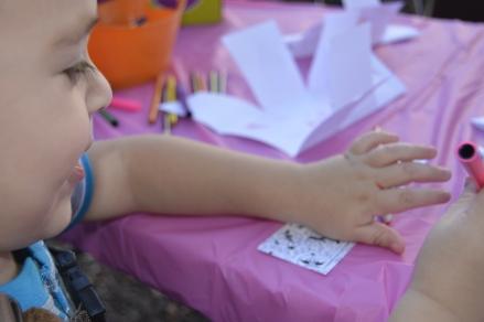 Coloring his bookmark
