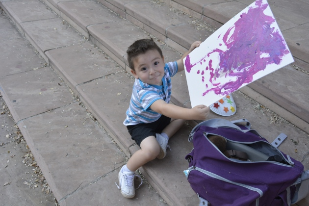 Showing off his completed painting