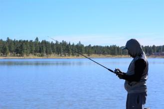 Intently fishing.